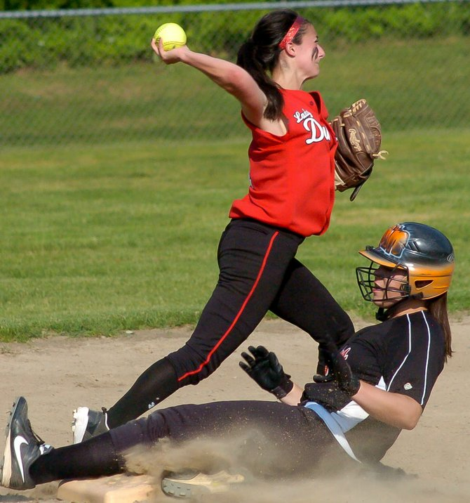 Guilderland shortstop Tori Greco throws on to first base after getting Bethlehem's Erin O'Donnell out during the second inning of Friday's Section II Class AA championship game at Clifton Common.