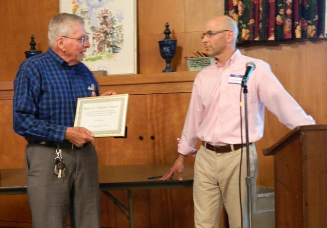 Cazenovia landscape architect Don Ferlow, left, received the Cazenovia Preservation Foundation's top award for environmental preservation from CPF President Carlos Gavilondo at the organization's May 23 annual meeting.