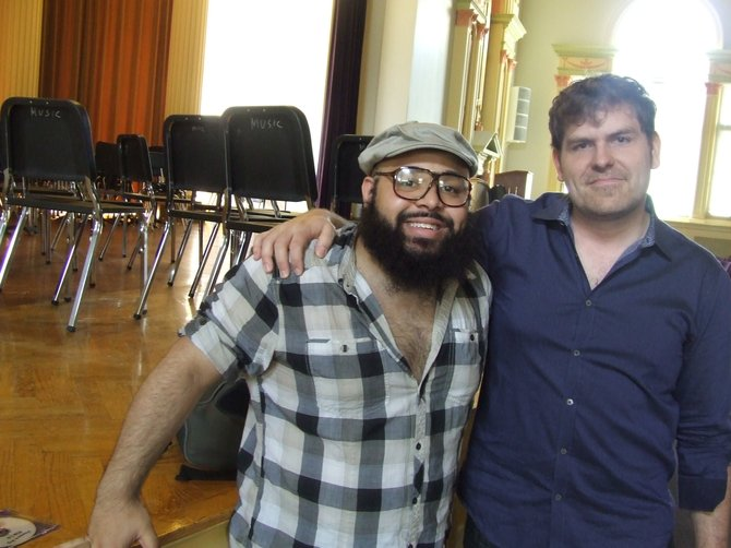 Ricardo Nigaglioni and Albany Symphony Orchestra Resident Composer Ted Hearne stand together after working with 12 students at the Hackett Middle School on a literacy through music project.
