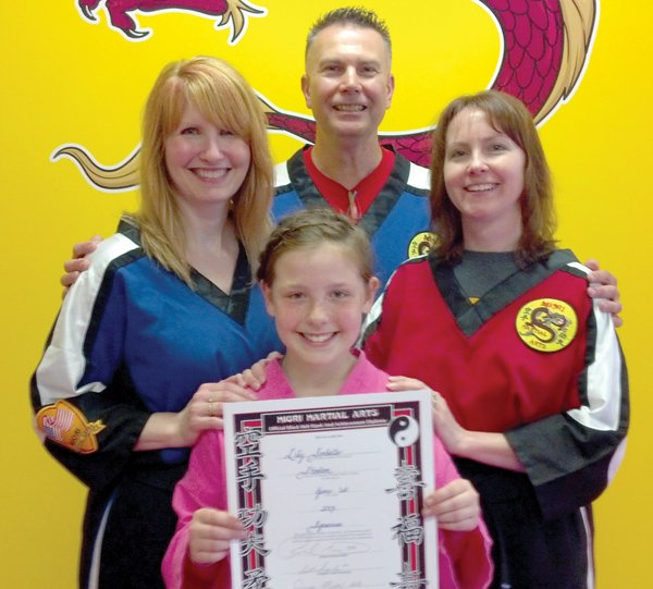 Lily Sorbello, front, celebrates her black belt achievement with Donna and Rick Miori, from left, and her instructor Master Beth Fragale.