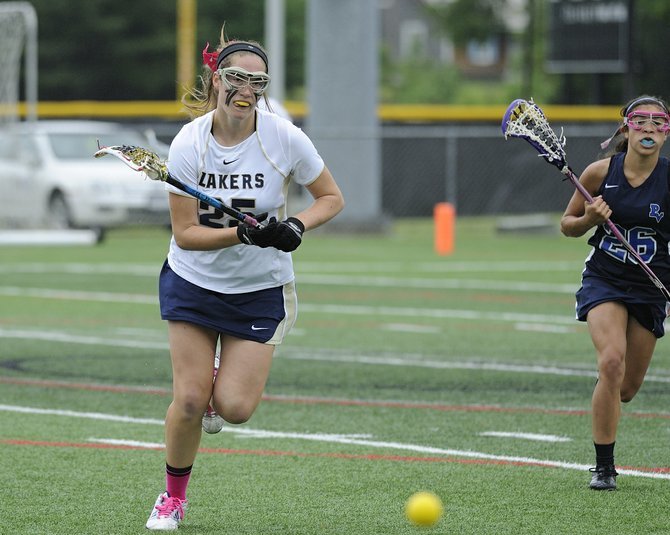 Skaneateles junior midfielder Alana Navaroli (25) chases down the loose ball during Friday's state Class C semifinal against Putnam Valley at SUNY-Cortland. Leading from start to finish, the Lakers defeated the Tigers 16-6.
