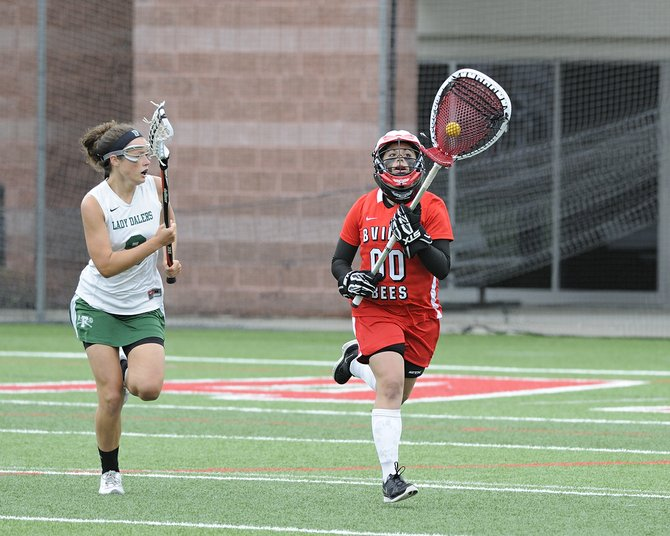 Baldwinsville goalie Nicole Burrows (00) makes a rare run out of the goal circle and down the field during last Saturday's state Class A final against Farmingdale. Despite Burrows' efforts, the Bees lost, 8-5, to the Dalers, falling just short of a second state title to go with the one it earned in 2000.
