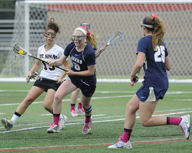 Skaneateles junior midfielder Molly Wood (8) turns and runs upfield in Saturday's state Class C final against Mount Sinai. In the Lakers' 15-6 defeat, Wood picked up three goals, adding to the six goals she scored in the semifinal win over Putnam Valley and earning a spot on the All-Tournament team.