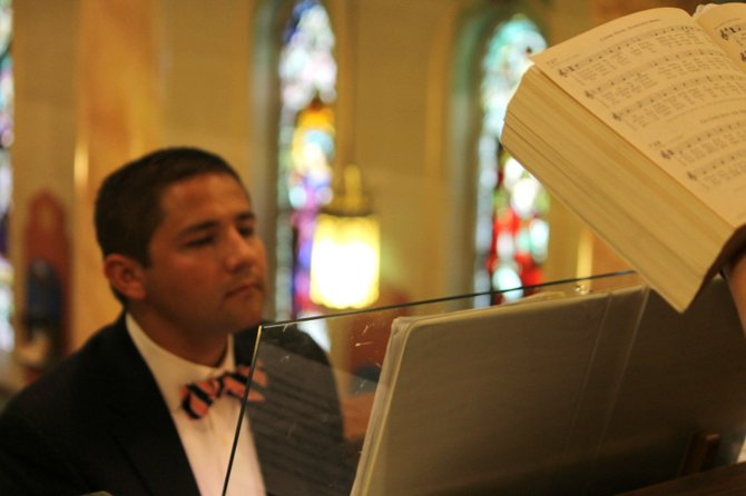 Jared Shepard plays the organ at St. Matthew's Mass in August 2012.