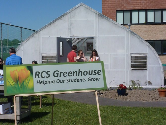 On Tuesday, June 4, faculty, students and parents gathered at RCS High School for a dedication ceremony and open house to showcase the school's new greenhouse.