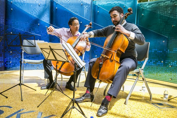 Kenneth Olsen (right) performs with Yo Yo Ma at the Lurie Children's Hospital in Chicago in May.
