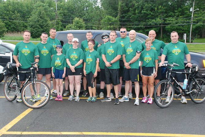 DeWitt Police Officers participate in the 2013 Law Enforcement Torch Run for the Special Olympics.