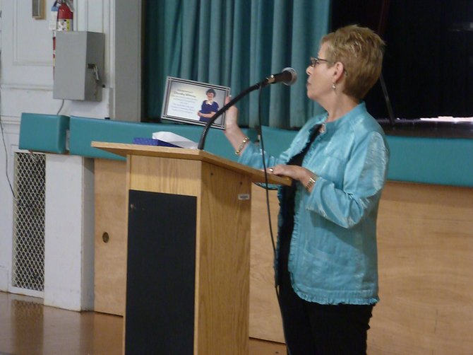Colleague Shari Piper remembers Whitney and presents the school with the new plaque.