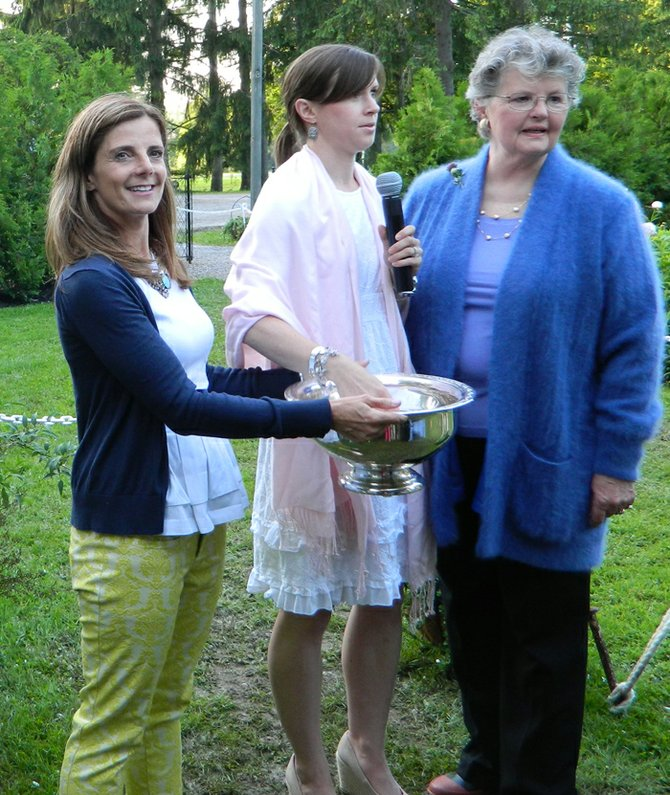 Friends of Lorenzo board President Casey Frazee, center, draws the winning raffle ticket for a catered dinner for eight in the Lorenzo gardens, assisted by FOL board members Leanne Burrell, left, and Suzanne Munger. The winner was Sharon Cooney.