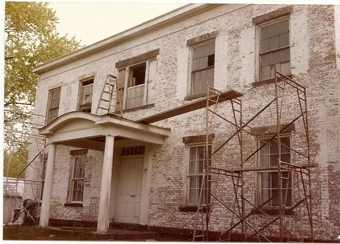 The Pruyn House in 1983, before renovations. The list of renovations included exterior masonry restoration; interior flooring restoration; fixing the heating, ventilation, A/C and climate control; roof replacement; and window restoration.