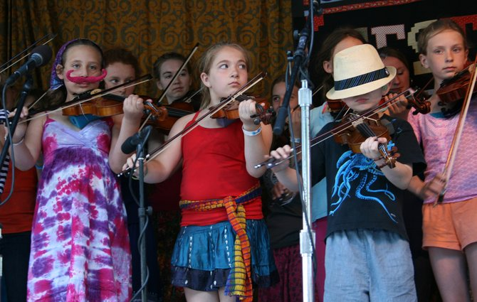 Children attending last year's Old Songs Festival rehearsed over the weekend and performed as the Great Groove Band on the final day of the event. This year kids can once again perform together in the band.