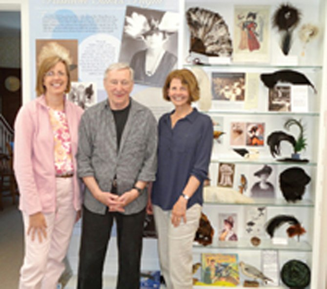 "Exhibit designers Julia Smith Shotzberger, Jonathan Holstein and Pat Hill stand in front of their creation, ""Fashion Takes Flight,"" a new permanent exhibit in the Cazenovia Public Library Museum."