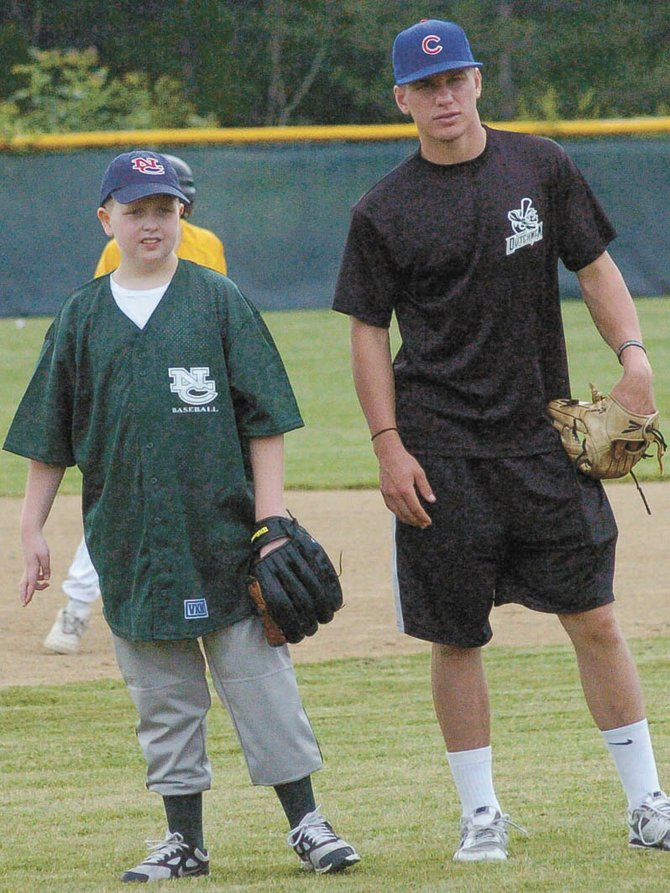 Albany Dutchmen infielder Zach Remillard, right, stands next to North Colonie Challenger Baseball player Robert Stiles during the season finale June 22 at the Boght Baseball Complex.