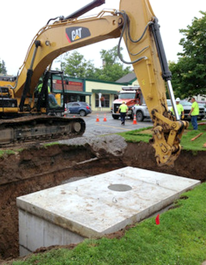 The village installed one of the storm water cisterns underground adjacent to the parking lot in front of Dave's Diner on Albany Street last week.