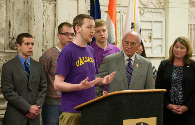 University at Albany senior Kevin Fox on Monday, July 1, stresses the burden on students and families of federally subsidized Stafford loans facing an increased interest rate of 6.8 percent.