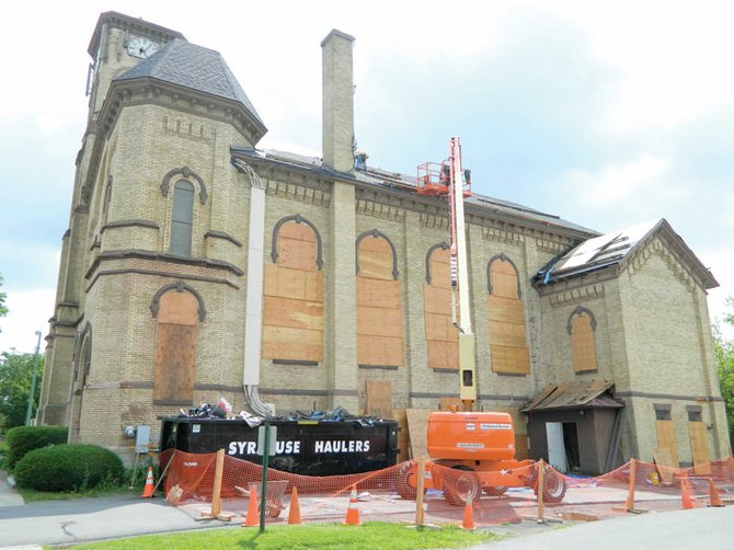 The United Methodist Church of Cazenovia is currently getting a new roof installed, with the hope that the work will be completed by the end of July. The church's stained glass windows have been boarded up to prevent accidental damage.
