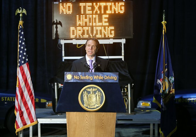 Gov. Andrew Cuomo on July 1 touts legislation creating new penalties for young and new drivers who text or use their phones while driving. Cuomo recently announced the state is increasing distracted driving enforcement efforts.