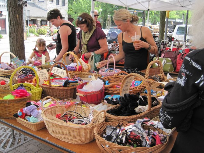 Sidewalk sales, music, food, a magic show and the Duck Dash will all be a part of this year's Curbstone Festival in Skaneateles. ABOVE: shoppers look through items for sale at last year's festival.
