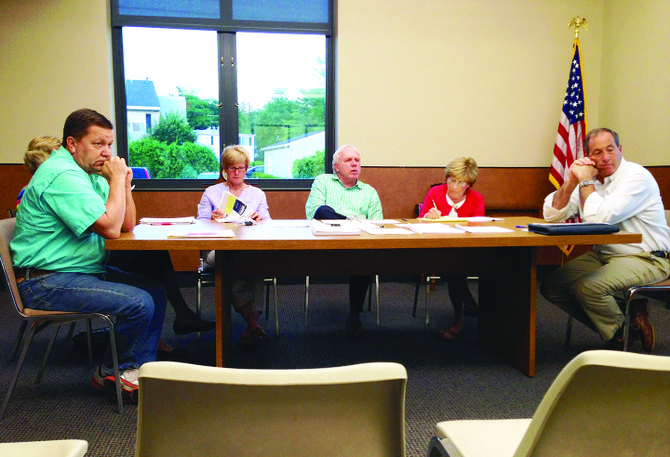From left: Trustees Jim Lanning, Sue Jones, Mayor Marty Hubbard, Village Clerk Patty Couch and Trustee Marc Angelillo at the first village board meeting to be held in the new Fennell Street village hall.