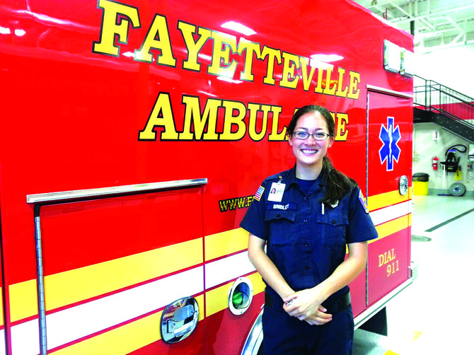 "Kira Gridley, 23, of Fayetteville, has been volunteering as an EMT at the Fayetteville Fire Department since 2009. ""I kind of fell in love with it,"" she said."