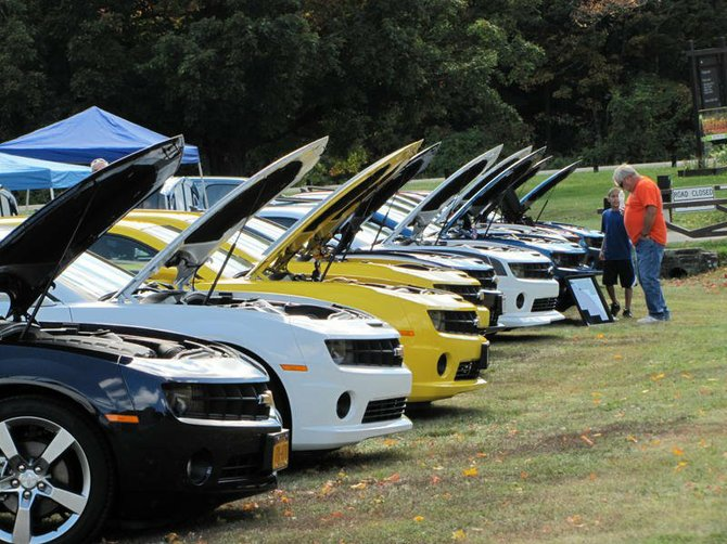 """To view some of the best man-made rides you'll have to trek into nature. Cars at """"Wheels in the Woods"""" at Thacher State Park on Saturday, July 27, will once again have hoods propped up and a glossy finish."""