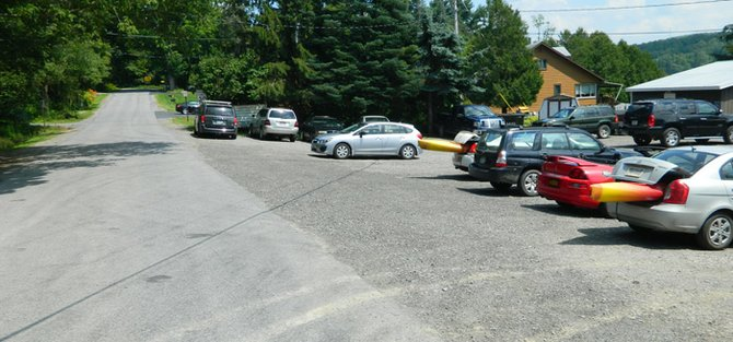 During peak times, the parking lot of the Blue Canoe Grill, right, will be full and both sides of North Lake Road, left, will have cars parked along it, which makes the road impassable for emergency vehicles.