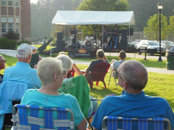 Town of Chester residents and visitors listen to the classic and contemporary rock music of the Master Cylinders band during a recent concert that featured two groups performing on the Chester Municipal Center lawn. This concert was the debut of the Music on Main Street series, jointly sponsored by the Tri-lakes Business Alliance and the town of Chester. The Alliance is launching new events and activities to revive downtown Chestertown as well as the entire northern Warren County region.