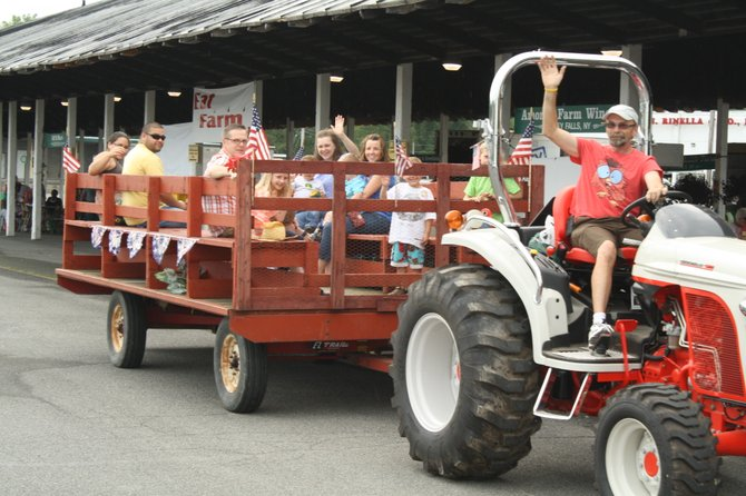 Family Day at the market will feature all sorts of activities for young and old, including tractor-pulled rides.