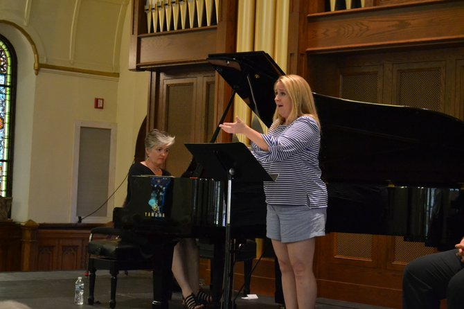 """Pianist Laura Ward and vocalist Jennifer Aylmer perform a movement from Leonard Bernstein's """"Arias and Barcarolles"""" at an open rehearsal in First Presbyterian Church on Aug. 7. They were joined by vocalist Randall Scarlata and pianist Elinor Freer to perform the piece as a pre-concert event on Aug. 8."""