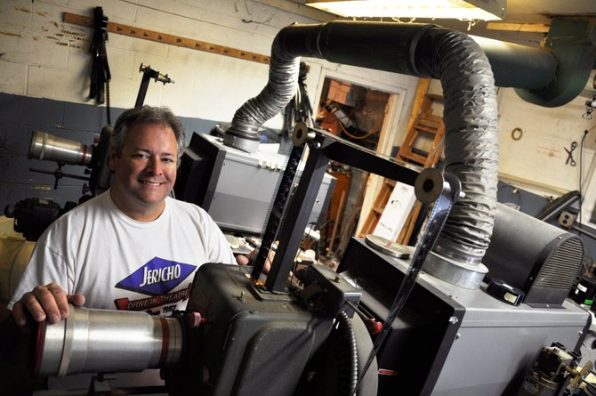 Mike Chenette, owner of Jericho Drive-in in Glenmont, inside the theater's film projection booth.
