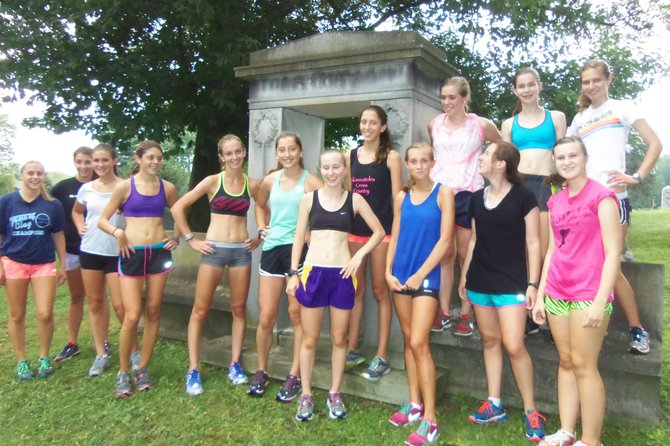 Skaneateles girls cross country runners relax after a tough summer workout in a local cemetery. The Lakers open its season Sept. 7 at the East Syracuse-Minoa Invitational with high hopes of winning its first Section III title in six years.