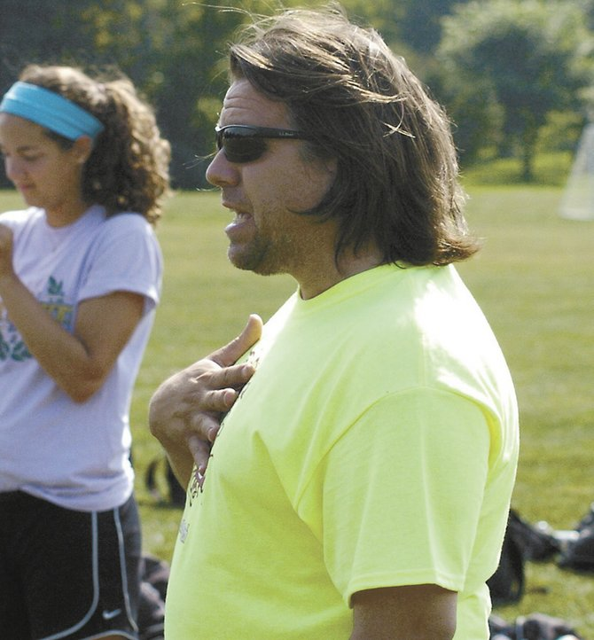 Curtis Snyder instructs his Guilderland girls soccer players.