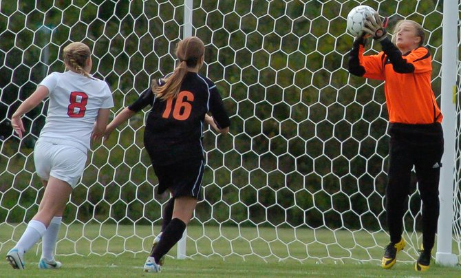Bethlehem goaltender Miranda Manziam, right, grabs the ball as two players come at her during a Sept. 3 Suburban Council South Division game at Guilderland High School.