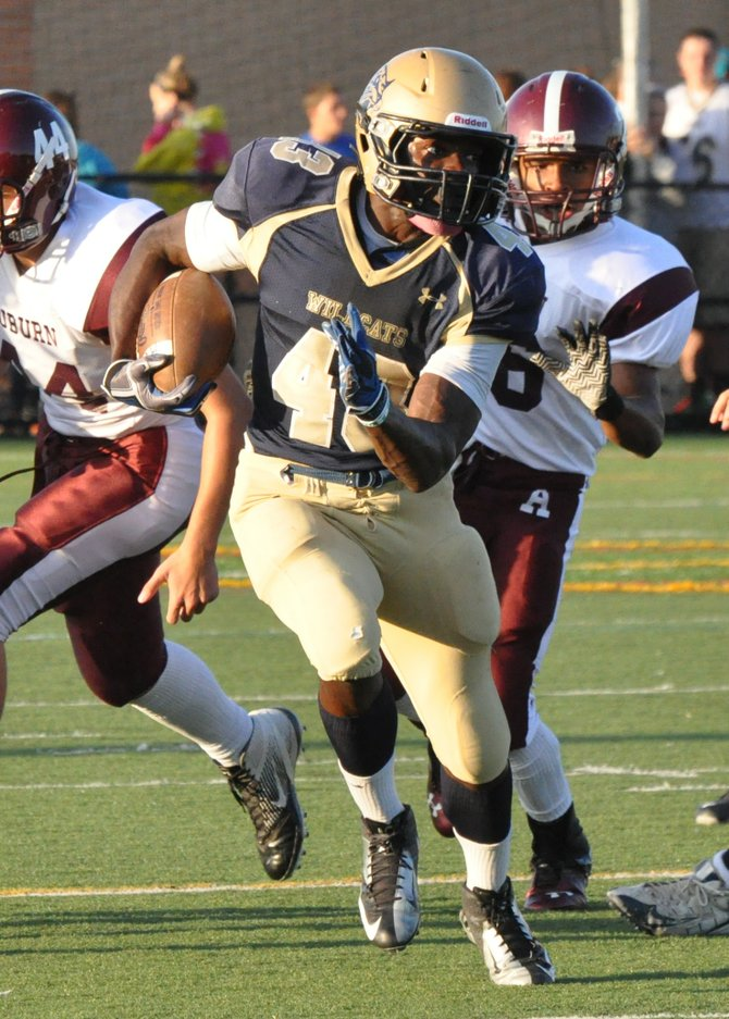 West Genesee senior tailback Naesean Howard (43) returned this kickoff 85 yards for a touchdown early in the second quarter to put his team ahead for good as the Wildcats beat Auburn 28-13 in Friday night's season opener. Howard also had 183 rushing yards and two more TD's on the offensive side.