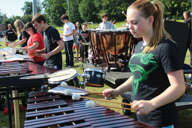 Kelly Cary Ashley Rausa, a member of the Baldwinsville Central School District Marching Band, concentrates on perfecting her part for the new marching band season.