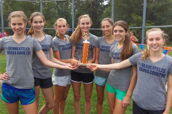Skaneateles girls cross country runners (from left) Jenn DeRosa, Julia Willcox, Elsa Soderberg, Madeline Adams, Morel Malcolm, Liz Dwyer and Kaitlyn Neal finished second amid a strong field at last Saturday's East Syracuse-Minoa Invitational. Only seven-time defending national champion Fayetteville-Manlius beat the Lakers.