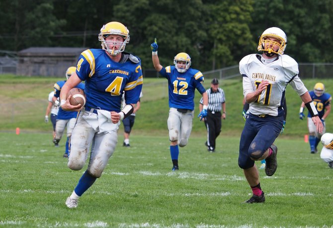 Cazenovia quarterback Kevin Hopsicker (4) races to the end zone on a 40-yard touchdown run in the third quarter of last Saturday's game against Central Valley Academy. The Lakers' 21 third-quarter points led to a 49-20 victory over the Thunder.