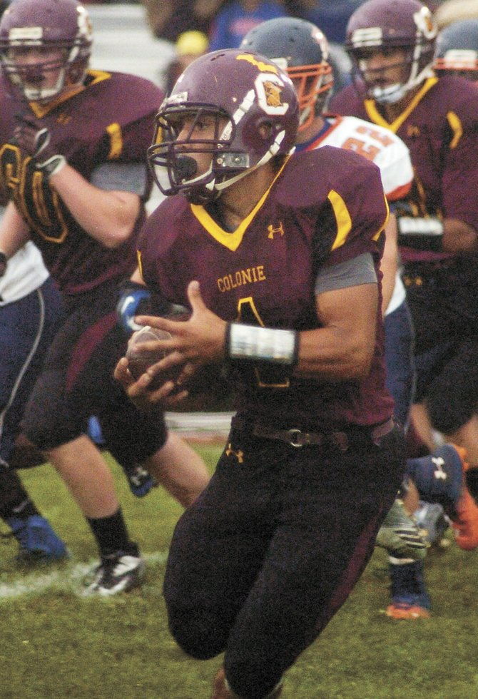 Colonie running back Devon Edwards sweeps to the sideline during a Sept. 13 non-league game against East Syracuse-Minoa.