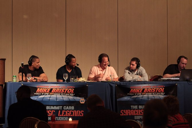 From left: Syracuse native and Oakland Raiders safety Tyvon Branch, Damien Rhodes, Mike Bristol and Eric Devondorf recording an episode of the NAPA Syracuse Legends Show.