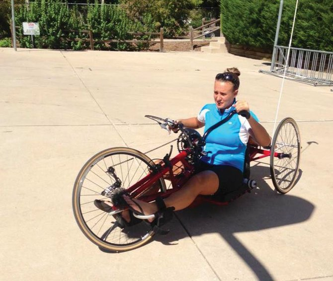 Erin Scala shown using a handcycle at the Paralympic Training Center in Colorado Springs, Colo.