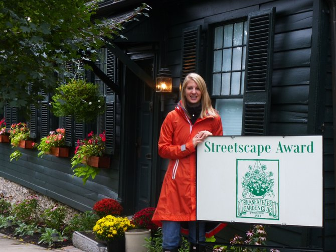 Jessica Weathers stands in front of her Leitch Avenue home, the recent recipient of the Skaneateles Garden Club's Streetscape Award.