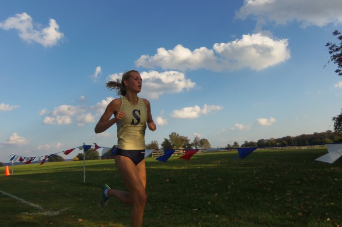 Skaneateles girls cross country junior Elsa Soderberg finishes the final climb before turning into the long trip leading to the finish line during Wednesday's home meet with Hannibal. Strong and confident, the junior placed second to help the Lakers to a 20-35 victory over the Warriors.