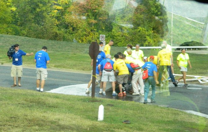 Volunteers and vets with Honor Flight Syracuse tore down a roadblock at the Iwo Jima Memorial during their trip to Washington on Saturday, Oct. 5, refusing to let a government shutdown bar them from visiting monuments to their military comrades.