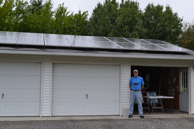 Dick Thompson at his Marietta home which has solar panels on the garage and a solar hot water system in the yard. He was featured on last weekend's alternative energy tour.