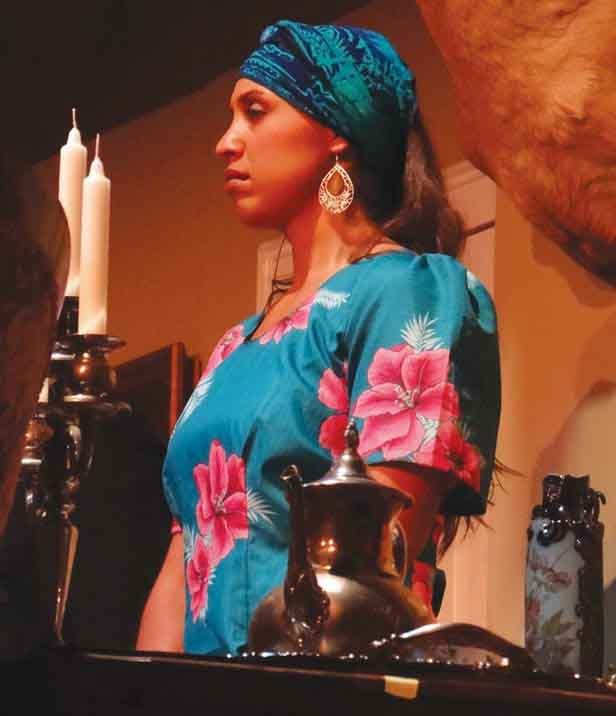 "Kitty Doupe, who works for the U.S. Army at Hancock Field, lights up the stage as Zenia, a spooky Haitian maid, in Baldwinsville Theatre Guild's current production, ""Any Number Can Die."""