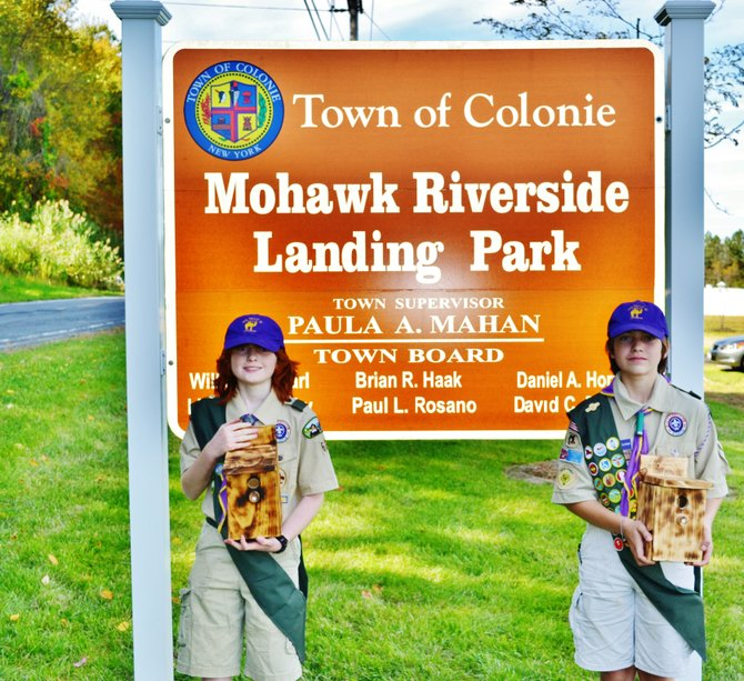 From left, brothers Evan and Caleb Czolowski, of Troop 62 display the bird feeders they built for the Mohawk Riverside Landing Park.