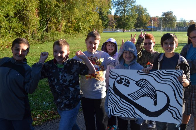 Minoa Elementary School fifth graders walk down Helfer Lane as a part of the school's 25 minute morning walk.