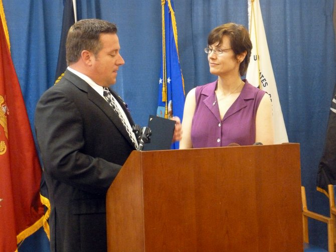 Albany County Executive Dan McCoy presents a proclamation to county Crime Victim and Sexual Violence Center Director Karen Ziegler on Wednesday, Oct. 2, during a kick off press conference for Domestic Violence Awareness Month.