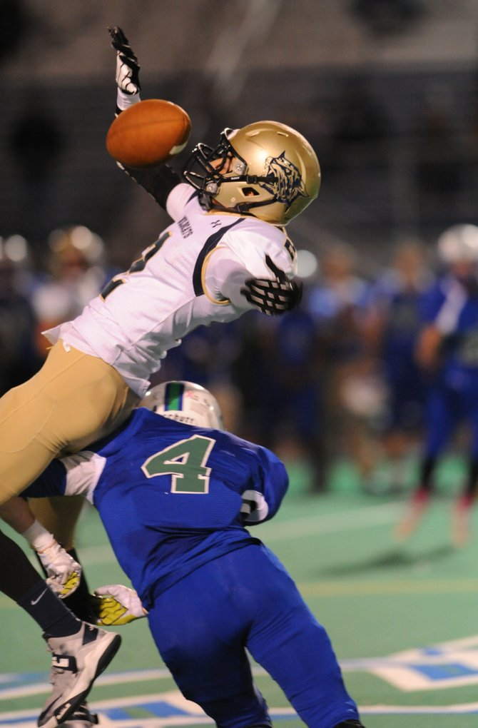 Cicero-North Syracuse defensive back Connor Evans (4) upends West Genesee wide receiver Michael Schmidt on a pass play during Friday night's game at Bragman Stadium, where the Northstars took a big step toward post-season qualification by defeating the Wildcats 28-24.