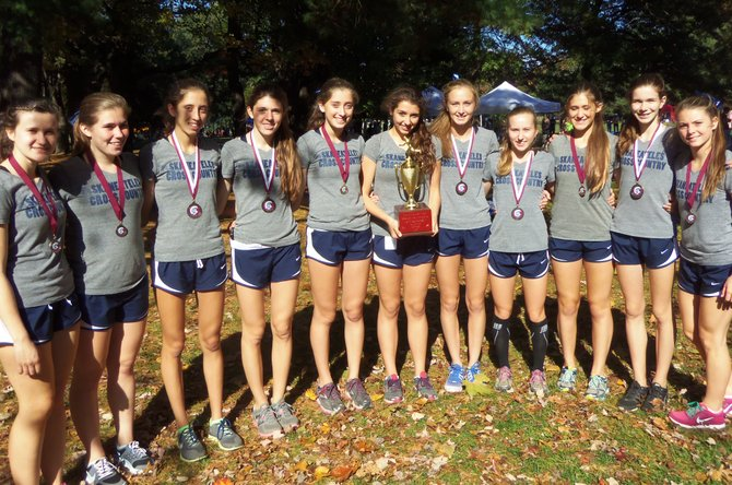 The Skaneateles girls cross country team with the first-place trophy from the Burnt Hills Invitational. From left: Ginny Hamlin, Maria Schillace, Morel Malcolm, Liz Dwyer, Finan Malcolm, Molly Stanton, Madeline Adams, Kaitlyn Neal, Jillian VanLeer, Julia Willcox, Makena Gorman.
